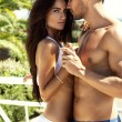 Sexy couple touching each other outdoor in summer ...