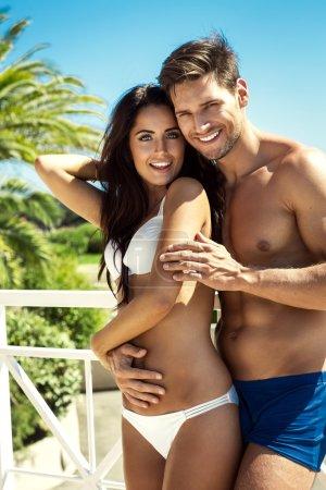 Happy couple wearing swimsuit