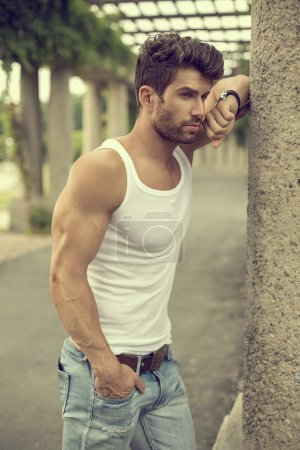 Strong and confident man posing outdoor