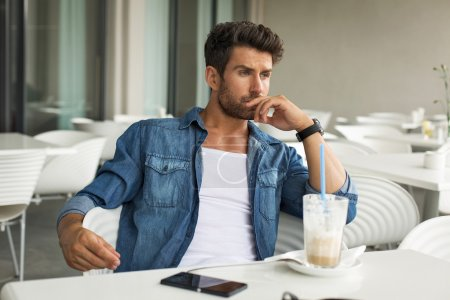 Young handsome man in cafe