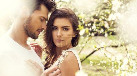 Sensual couple touching in the garden