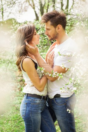 Couple touching each other in the garden