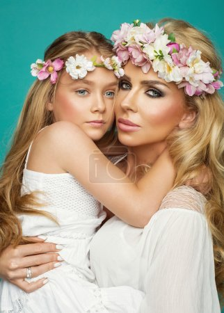 mother and daughter with flower garland