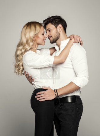 Handsome man kissing young beautiful blond woman