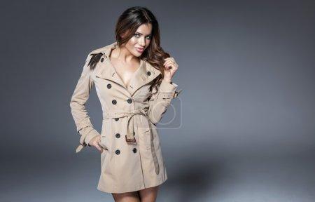Beautiful woman posing in coat