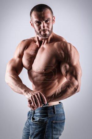 muscular man posing shirtless