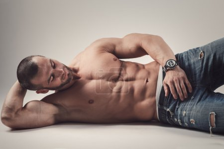 Photo for Handsome muscular shirtless man posing in studio - Royalty Free Image