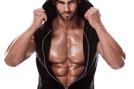muscular man posing in hoodie