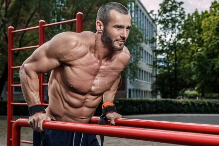 Photo for Muscular man during workout on street - Royalty Free Image