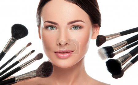 woman face and makeup brushes