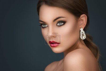 woman with luxury earrings