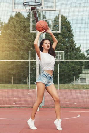 Woman on  on basketball court