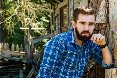 Bearded man in checkered shirt