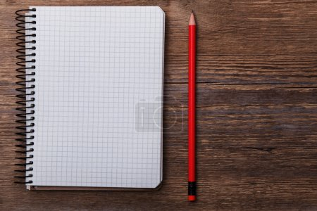 Photo for Empty notepad on wooden surface and red pencil - Royalty Free Image