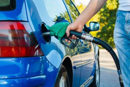 Man refuel his car