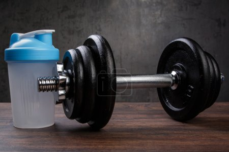 Dumbbells and shaker for protein cocktail