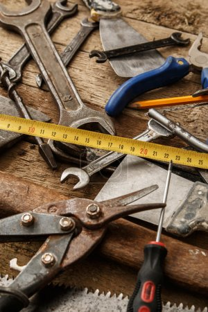 Photo for Different industrial tools over wooden surface - Royalty Free Image