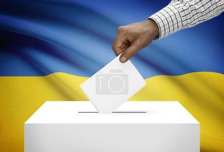 Ballot box with national flag on background - Ukraine