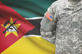 American soldier with flag on background - Mozambique