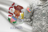American soldier with US state flag on background - Illinois