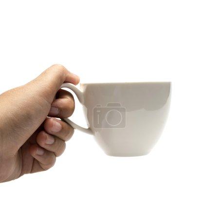 Photo pour Main tenant la tasse à café isolé sur fond blanc - image libre de droit