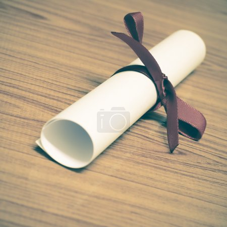 White diploma with ribbon