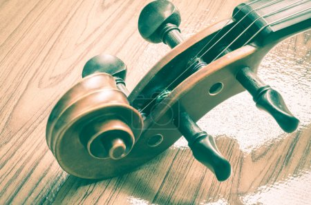 Photo for String instrument violin on wood background vintage style - Royalty Free Image