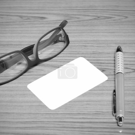 bussiness card and pen with glasses black and white color tone s