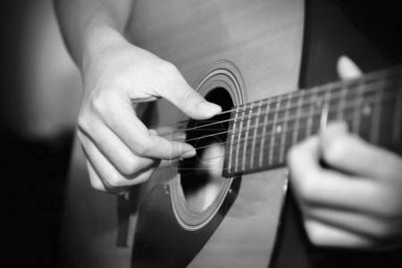 still life man playing guitar black and white color tone style