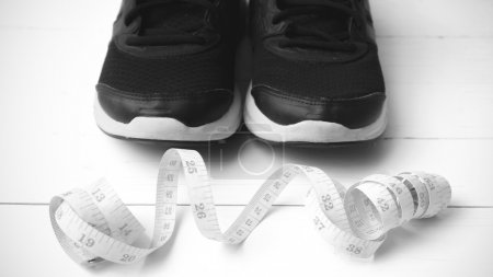 running shoes and measuring tape black and white tone color styl