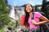 Healthy hiker girl drinking water