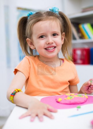 Photo for Little Girl Playing with Color Play Dough - Royalty Free Image