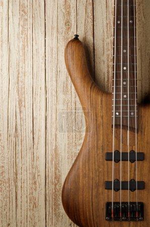 bass guitar on wood