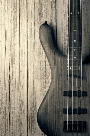 bass on wood vintage photo