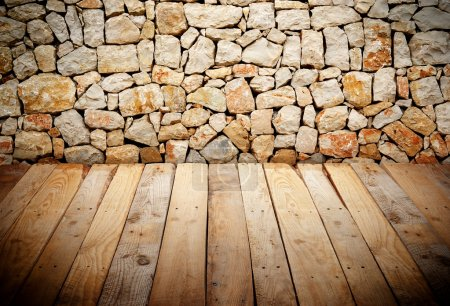 Wooden slats with stone wall