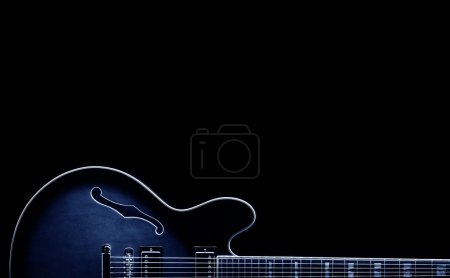 Photo for Blues classic guitar shape on black background - Royalty Free Image