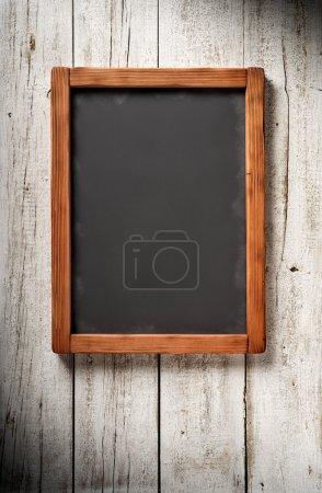 Old blackboard on aged wall
