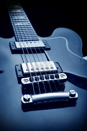 Photo for Classic semi-hollow body electric guitar, blue image - Royalty Free Image