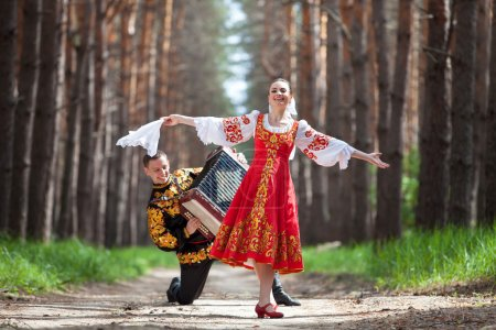 Photo for Couple of dancers in russian traditional costumes - Royalty Free Image