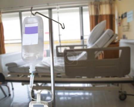 Infusion pump and IV hanging on pole in hospital