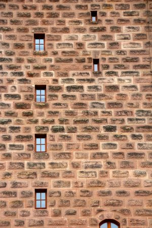 ancient wall with small windows displayed