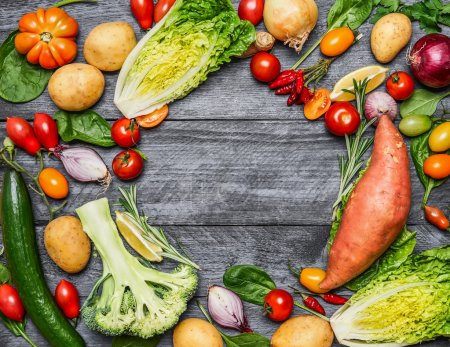 Photo for Colorful various of organic farm vegetables on light blue wooden background, top view. Healthy food, cooking and vegetarian concept. - Royalty Free Image