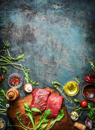 Photo for Beef steaks and various ingredients for cooking on rustic wooden background, top view, frame.  Healthy, diet food concept. - Royalty Free Image
