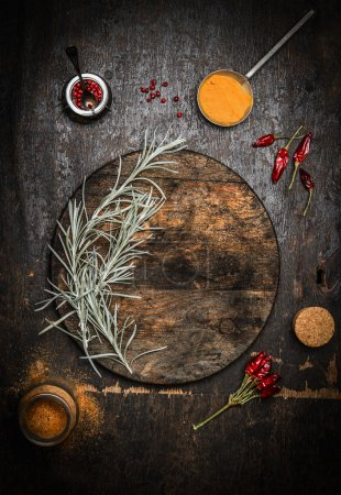 Photo for Wooden food background with old dark chopping cutting board, herbs and spices, top view - Royalty Free Image