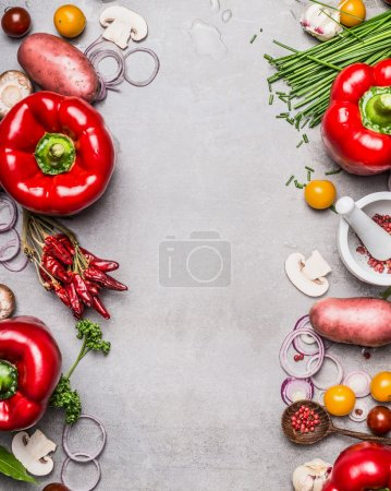 Photo for Red paprika and diverse vegetables and cooking ingredients on gray stone background, top view, frame, vertical. Vegetarian food and healthy lifestyle concept. - Royalty Free Image