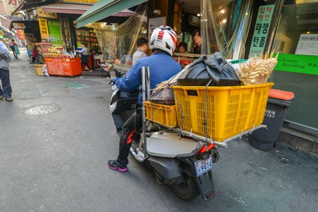 A man on a bike with huge load on the back Dongdaemun area in Seoul