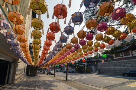 A lot of colorful chinese lanterns hanging above the pavement in Bukchon district, Seoul, Korea