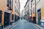 STOCKHOLM, SWEDEN - CIRCA JULY 2014: narrow side street with bright painted buildings in old town Gamla Stan in Stockholm, Sweden circa July 2014.