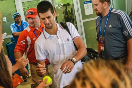 CINCINNATI, OH - CIRCA 2011: a crowd greets Novak Djokovic at Lindner Family Tennis Center on after finals at Western & Southern Open tournament in Cincinnati, OH, USA at summer 2011.