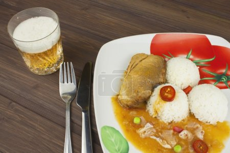 Slice roast pork with rice and sauce. Preparing homemade food. Delicious home-cooked meal for one person.